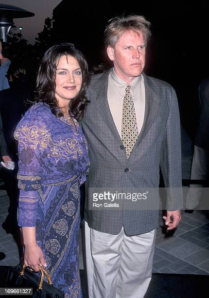 Actor Gary Busey and wife Tiani Warden attend the Deep Impact Hollywood Premiere on April 29 1998 at Paramount Pictures Studios in Hollywood...
