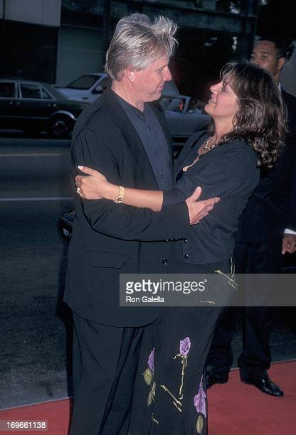Actor Gary Busey and wife Tiani Warden attend the Screening of the TNT Original Movie Rough Riders on July 17 1997 at the Academy Theatre in Beverly...