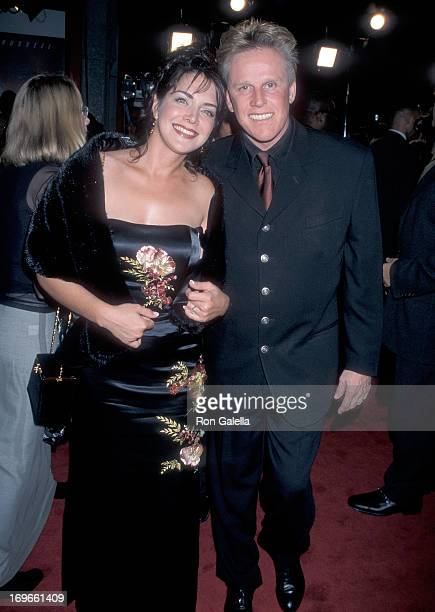 Actor Gary Busey and wife Tiani Warden attend the Soldier Hollywood Premiere on October 21 1998 at the Mann's Chinese Theatre in Hollywood California