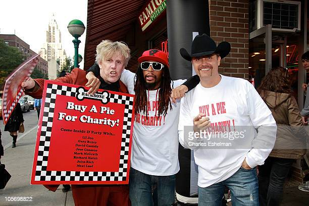 Actor Gary Busey rapper Lil Jon and country singer John Rich attend a pizza sale to benefit Grassroot Soccer at Famiglia Pizzaria on October 19 2010...