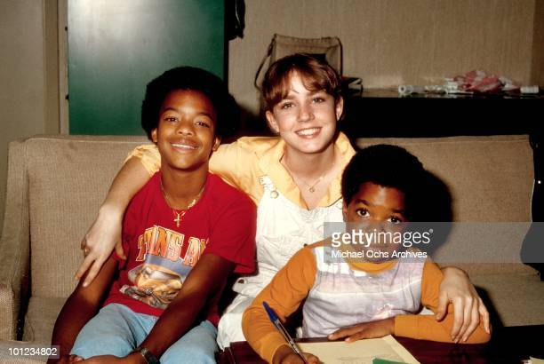 Actor Gary Coleman poses for a portrait with costars Dana Plato and Todd Bridges while studying on the set of his show 'Diff'rent Strokes' in...