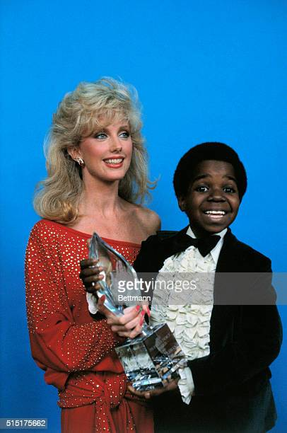 Actor Gary Coleman poses with People's Choice Award which he won for favorite Young Television Performer Beside him is the presenter of the Award...