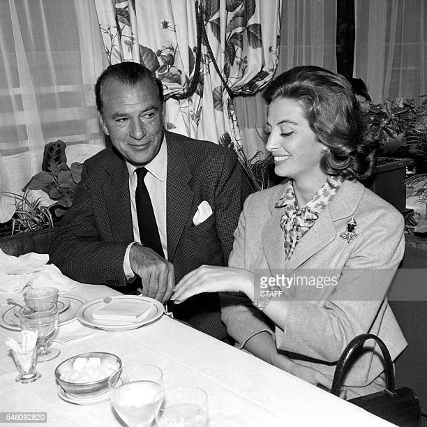 Actor Gary Cooper and French actress Capucine pose on August 1 in a restaurant in Hollywood, California. / AFP / -