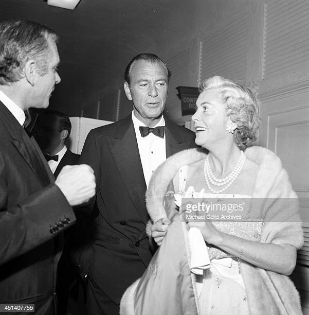 Actor Gary Cooper and his wife Veronica Balfe attend a party in Los Angeles,California.