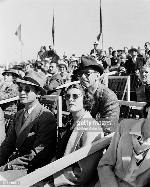 Actor Gary Cooper and wife Veronica Balfe and Franchot Tone attend an event in Los Angeles California