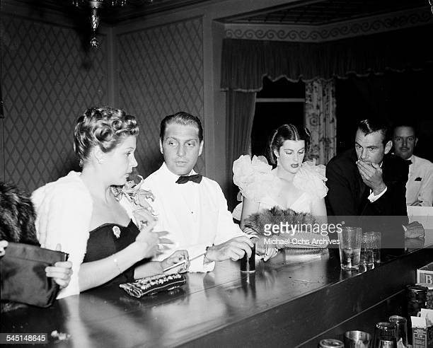 Actor Gary Cooper and wife Veronica Balfe stand a the bar during an event in Los Angeles California