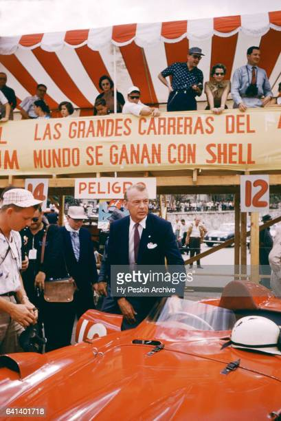 Actor Gary Cooper gets ready to sit in Alfonso 'Marquis' de Portago's car before the Grand Prix of Cuba race on Feburary 24 1957 in Havana Cuba