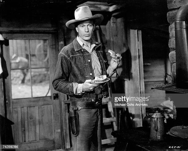 Actor Gary Cooper poses for a portrait in a film still from circa 1940.