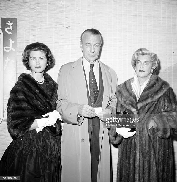Actor Gary Cooper poses with wife Veronica Balfe and their daughter Maria Cooper as they attend a WAIF ball in Los Angeles,California.