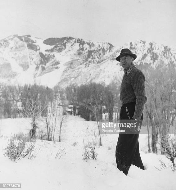 Actor Gary Cooper standing on the site where his new family home will be built, overlooking the lake and mountains of Montana, circa 1945.