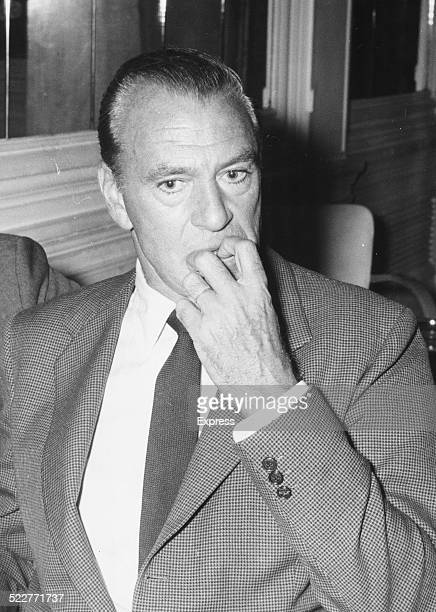 Actor Gary Cooper with his hand to his face at a press conference for his new movie in London October 1st 1960