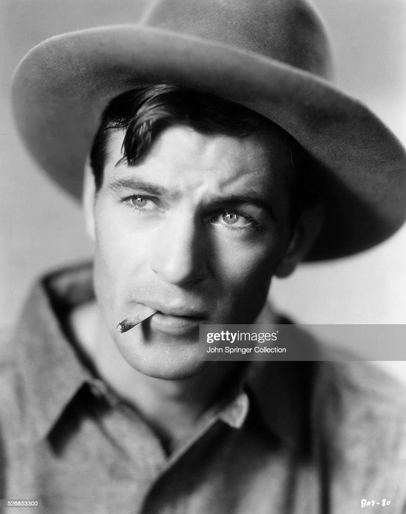 Actor Gary Cooper Smoking a Cigarette : News Photo