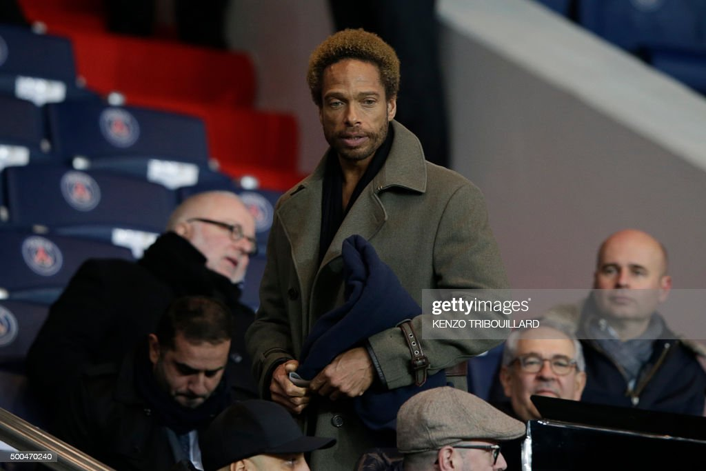 US actor Gary Dourdan (C) attends the UEFA Champions League Group A football match between Paris-Saint-Germain and Shakhtar Donetsk on December 8, 2015 at the Parc des Princes stadium in Paris.