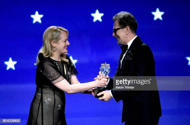 Actor Gary Oldman accepts Best Actor for 'Darkest Hour' from actor Elisabeth Moss onstage during The 23rd Annual Critics' Choice Awards at Barker...
