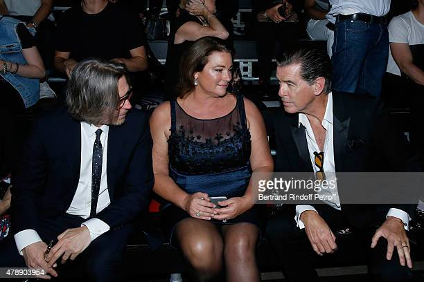 Actor Gary Oldman Actor Pierce Brosnan and his wife Journalist Keely Shaye Smith attend the Saint Laurent Menswear Spring/Summer 2016 show as part of...