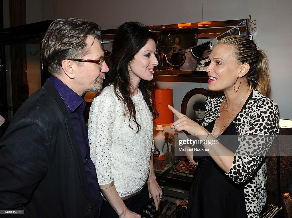 Actor Gary Oldman, Alexandra Edenborough and actress Molly Sims attend the Launch Party for Kishani Perera's new book, 'Vintage Remix' at Rummage on April 18, 2012 in Los Angeles, California.