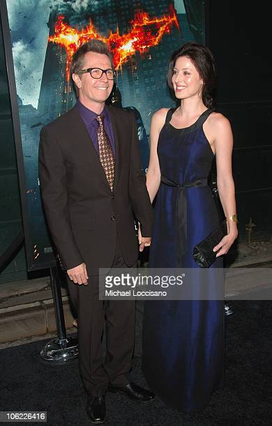 """Actor Gary Oldman and Alex Edenborough attend """"The Dark Knight"""" premiere at the AMC Loews Lincoln Square theater on July 14, 2008 in New York City."""