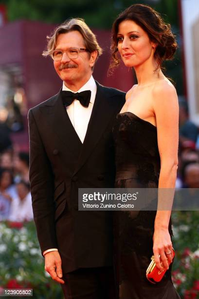 Actor Gary Oldman and Alexandra Edenborough attend the 'Tinker Tailor Soldier Spy' premiere at the Palazzo del Cinema during the 68th Venice Film...
