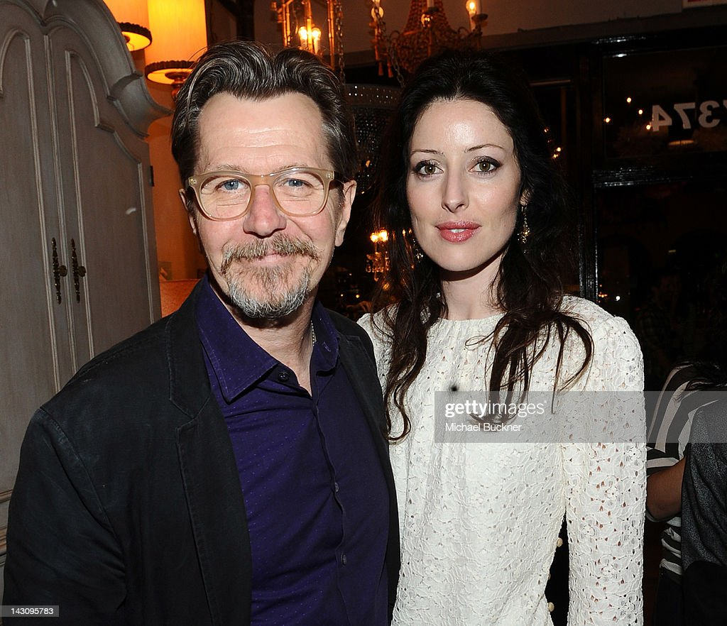 Actor Gary Oldman (L) and Alexandra Edenborough attends the Launch Party for Kishani Perera's new book, 'Vintage Remix' at Rummage on April 18, 2012 in Los Angeles, California.