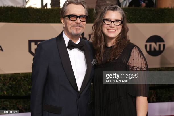Actor Gary Oldman and Gisele Schmidt arrive for the 24th Annual Screen Actors Guild Awards at the Shrine Exposition Center on January 21 in Los...
