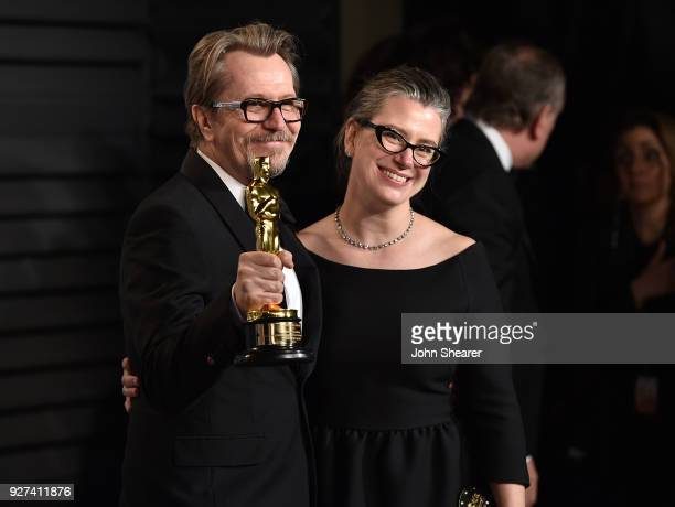 Actor Gary Oldman and Gisele Schmidt attend the 2018 Vanity Fair Oscar Party hosted by Radhika Jones at Wallis Annenberg Center for the Performing...