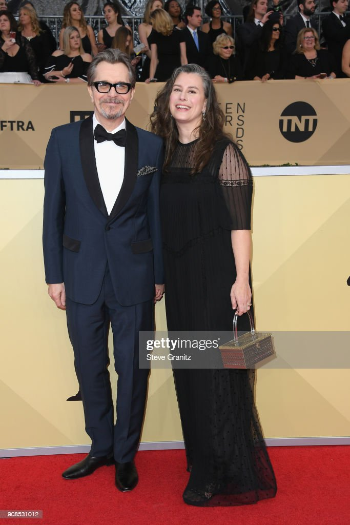 Actor Gary Oldman (L) and Gisele Schmidt attend the 24th Annual Screen Actors Guild Awards at The Shrine Auditorium on January 21, 2018 in Los Angeles, California.