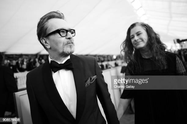 Actor Gary Oldman and Gisele Schmidt attend the 24th Annual Screen Actors Guild Awards at The Shrine Auditorium on January 21 2018 in Los Angeles...
