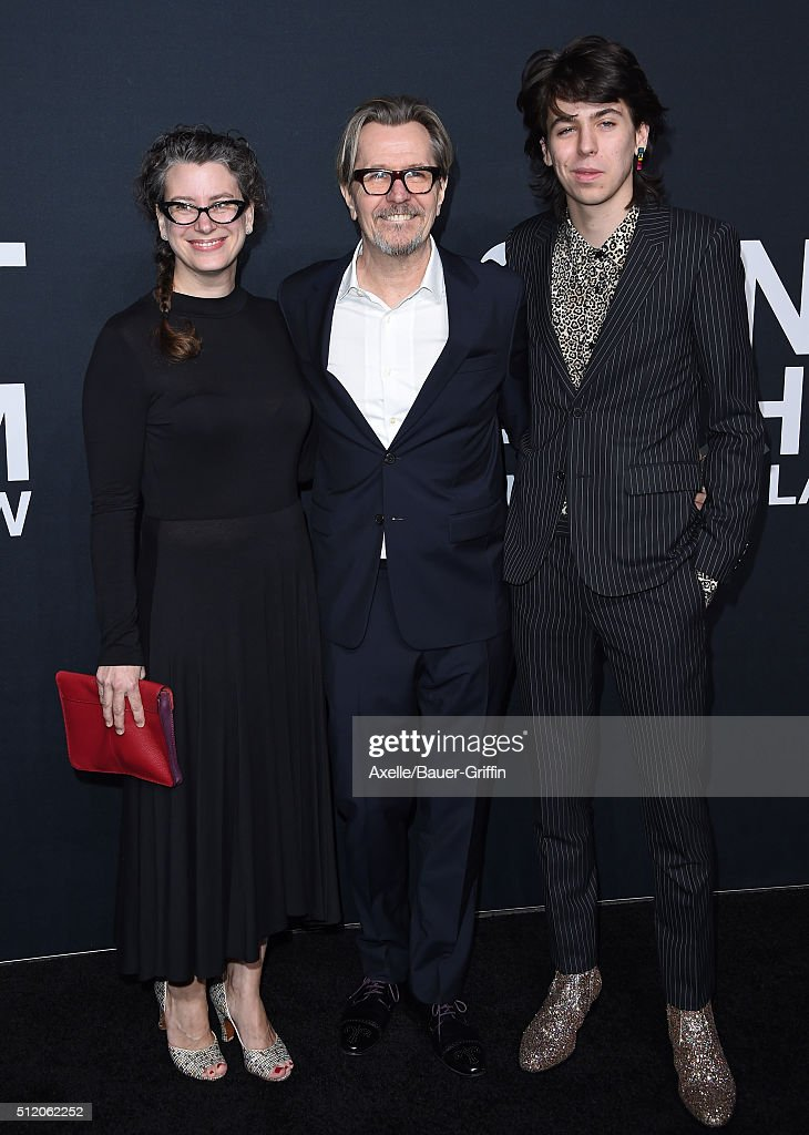 Actor Gary Oldman and guest arrive at SAINT LAURENT At The Palladium at Hollywood Palladium on February 10, 2016 in Los Angeles, California.