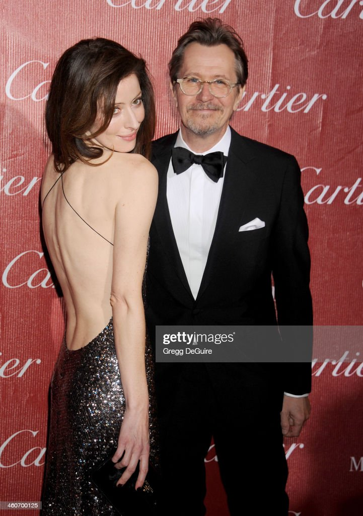 Actor Gary Oldman (R) and wife Alexandra Edenborough arrive at the 25th Annual Palm Springs International Film Festival Awards Gala at Palm Springs Convention Center on January 4, 2014 in Palm Springs, California.