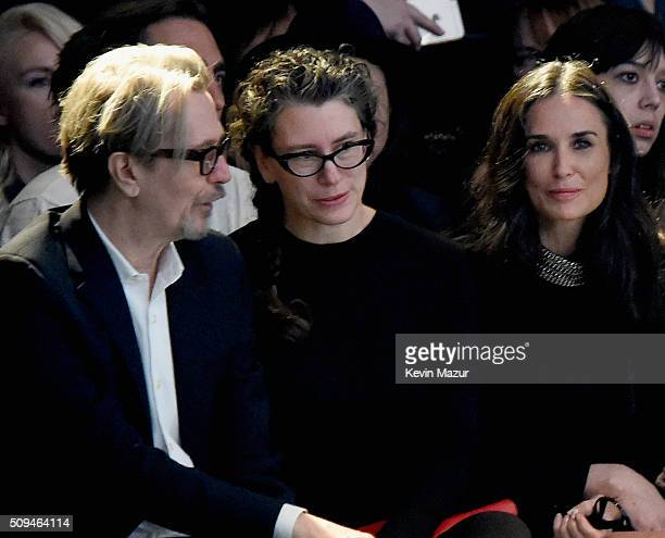Actor Gary Oldman Gisele Schmidt and actress Demi Moore attend Saint Laurent at the Palladium on February 10 2016 in Los Angeles California for the...