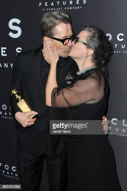 Actor Gary Oldman kisses his wife Gisele Schmidt at 2018 American Rescue Dog Show on January 7 2018 in Beverly Hills California