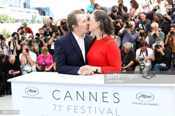 Actor Gary Oldman kisses wife Gisele Schmidt at the RendezVous with Gary Oldman Photocall during the 71st annual Cannes Film Festival at Palais des...