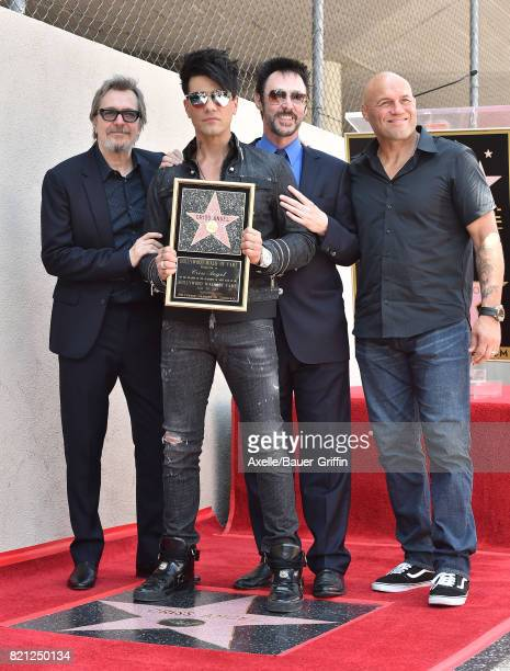 Actor Gary Oldman magicians Criss Angel Lance Burton and actor Randy Couture attend the ceremony honoring Criss Angel with star on the Hollywood Walk...