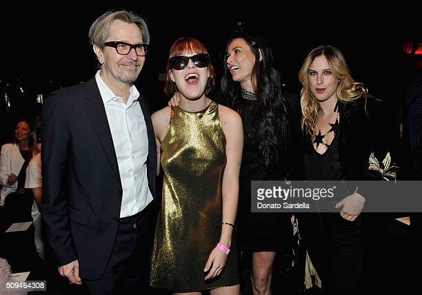 Actor Gary Oldman model Tallulah Willis actress Demi Moore in Saint Laurent by Hedi Slimane and actress Scout Willis attend Saint Laurent at the...