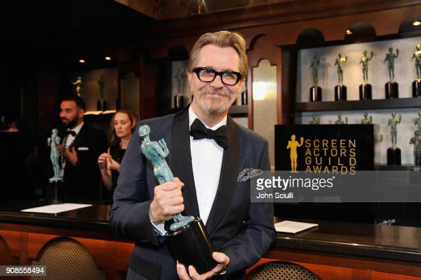 Actor Gary Oldman poses in the trophy room at the 24th Annual Screen Actors Guild Awards at The Shrine Auditorium on January 21 2018 in Los Angeles...