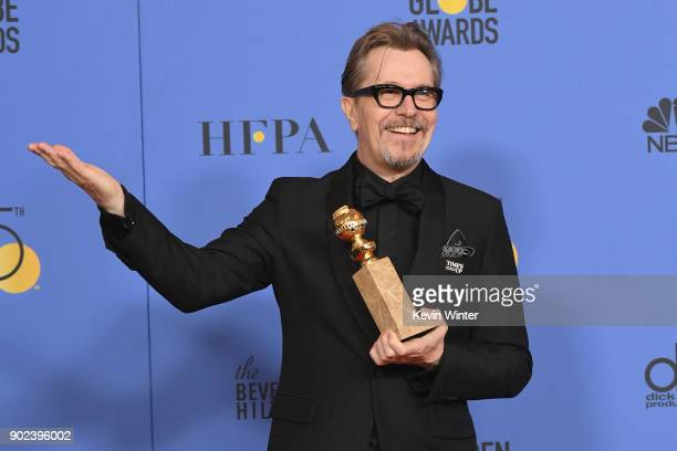Actor Gary Oldman poses with the award for Best Performance by an Actor in a Motion Picture Drama for 'Darkest Hour' in the press room during The...