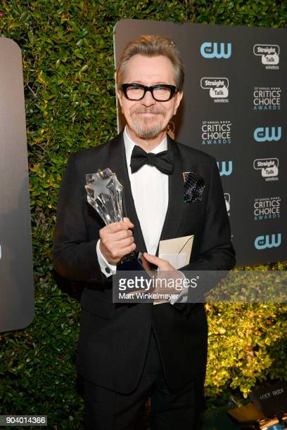 Actor Gary Oldman poses with the Best Actor award for 'Darkest Hour' during The 23rd Annual Critics' Choice Awards at Barker Hangar on January 11...