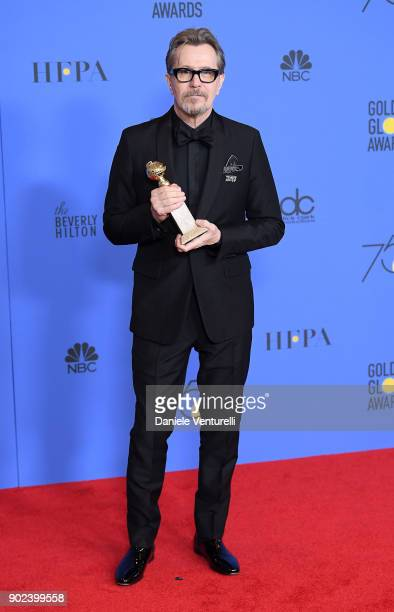 Actor Gary Oldman poses with the Best Performance by an Actor in a Motion Picture Drama award for 'Darkest Hour' in the press room during the 75th...