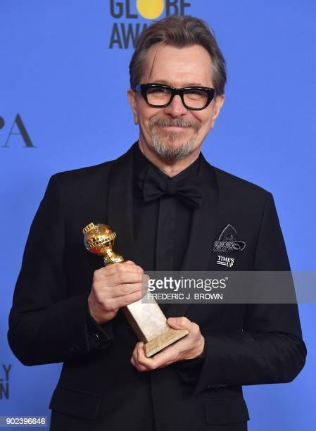 TOPSHOT Actor Gary Oldman poses with the trophy for Best Performance by an Actor in a Motion Picture Drama during the 75th Golden Globe Awards on...