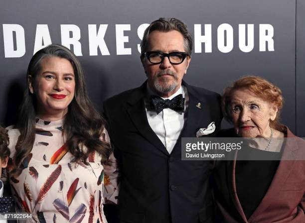 Actor Gary Oldman poses with wife writer Gisele Schmid and mother Kathleen Oldman at the premiere of Focus Features' 'Darkest Hour' at the Samuel...