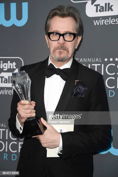 Actor Gary Oldman recipient of the Best Actor award for 'Darkest Hour' poses in the press room during The 23rd Annual Critics' Choice Awards at...