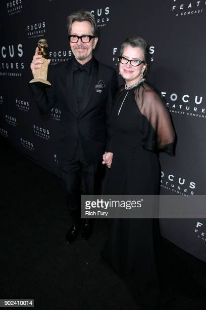 Actor Gary Oldman recipient of the Best Performance by an Actor in a Motion Picture Drama award for 'Darkest Hour' and Gisele Schmidt attend Focus...