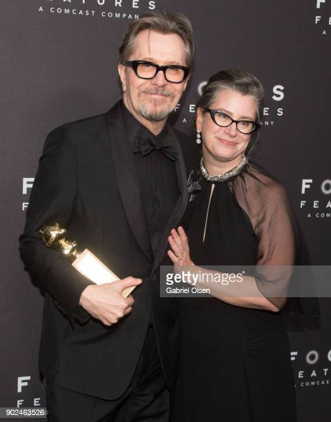 Actor Gary Oldman recipient of the Best Performance by an Actor in a Motion Picture Drama award for 'Darkest Hour' and wife Gisele Schmidt attend the...