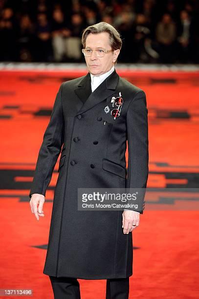 Actor Gary Oldman walks the runway at the Prada Autumn Winter 2012 fashion show during Milan Menswear Fashion Week on January 15 2012 in Milan Italy