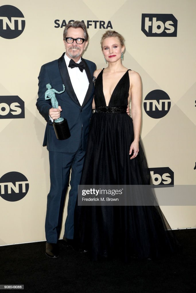 Actor Gary Oldman, winner of Outstanding Performance by a Male Actor in a Leading Role for 'Darkest Hour', and host Kristen Bell pose in the press room during the 24th Annual Screen Actors Guild Awards at The Shrine Auditorium on January 21, 2018 in Los Angeles, California. 27522_017