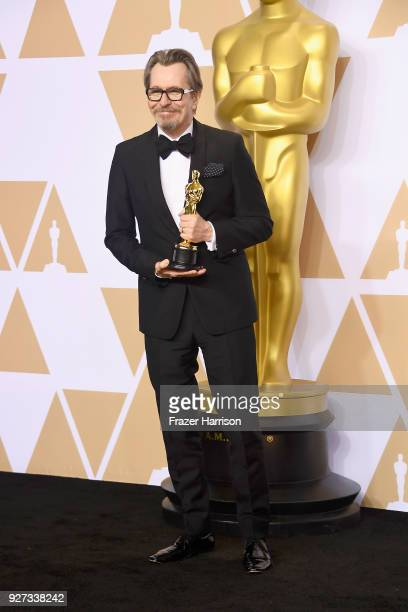 Actor Gary Oldman winner of the Best Actor award for 'Darkest Hour' poses in the press room during the 90th Annual Academy Awards at Hollywood...
