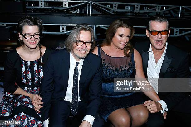 Actor Gary Oldman with his wife Gisele Schmidt and Actor Pierce Brosnan with his wife Journalist Keely Shaye Smith attend the Saint Laurent Menswear...