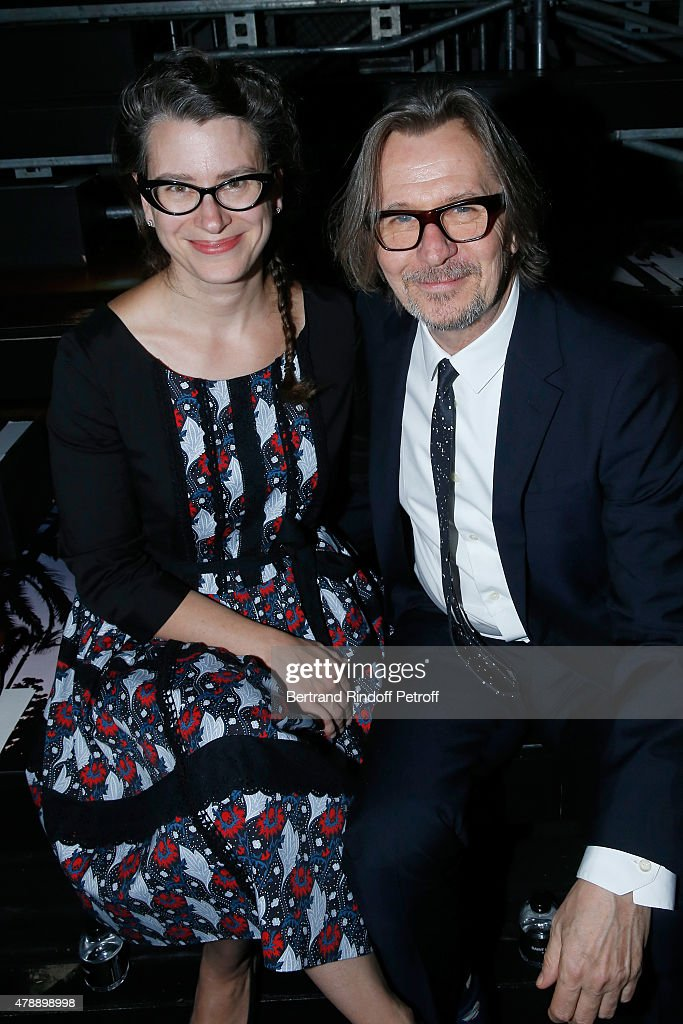 Actor Gary Oldman with his wife Gisele Schmidt attend the Saint Laurent Menswear Spring/Summer 2016 show as part of Paris Fashion Week on June 28, 2015 in Paris, France.