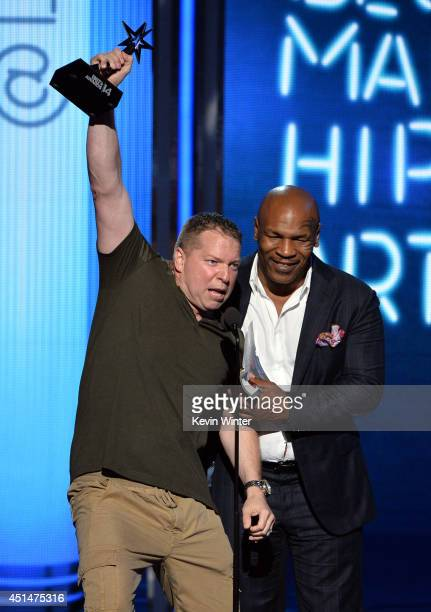 Actor Gary Owen and former boxer Mike Tyson speak onstage during the BET AWARDS '14 at Nokia Theatre LA LIVE on June 29 2014 in Los Angeles California