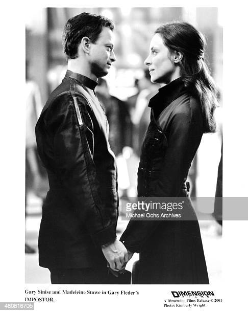 Actor Gary Sinise and actress Madeleine Stowe in a scene from the Dimension movie Impostor circa 2001